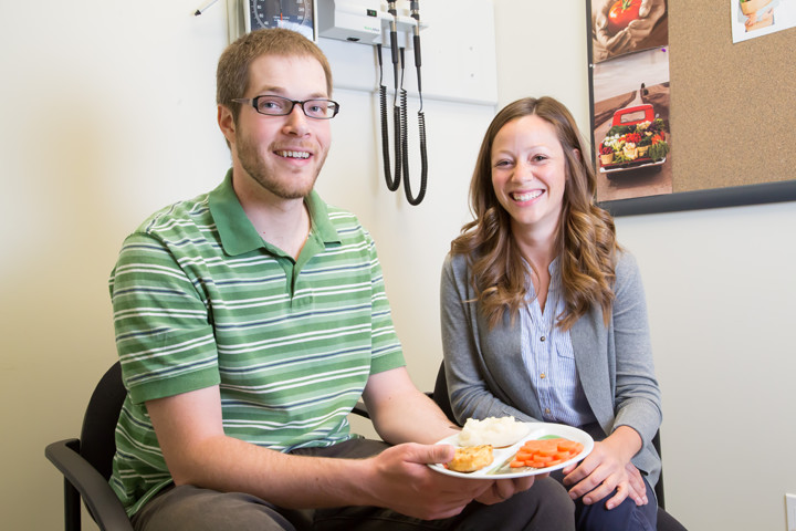 Registered dietitian Kari Derbyshire, right, with patient John-David Malta