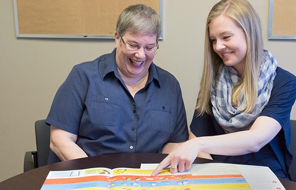 Dietitian Carmen Prion-Frank discusses nutrition questions with patient Cheryl Aitkens