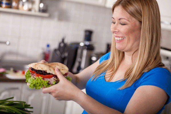 Pregnant woman eating a healthy pita